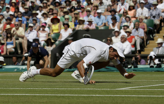 Serbia's Novak Djokovic on the floor in his Men's Final against Great Britain's Andy Murray during day thirteen of the Wimbledon Championships at The All England Lawn Tennis and Croquet Club, Wimbledon.