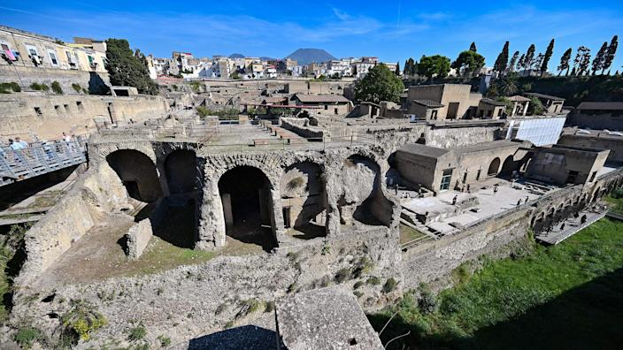 Image: The archaeological site of Herculaneum in Ercolano, near Naples, with the Mount Vesuvius volcano in the background, Italy. (Andreas Solaro / AFP via Getty Images file)