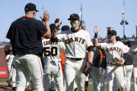 San Francisco Giants' Austin Slater, middle, celebrates with teammates after the Giants defeated the San Diego Padres in a baseball game in San Francisco, Saturday, May 8, 2021. (AP Photo/Jeff Chiu)