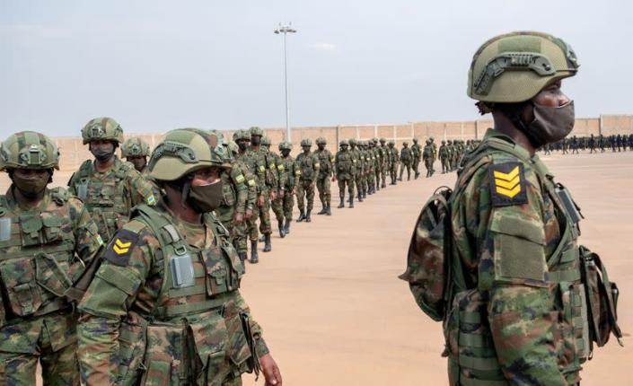 FILE PHOTO: Rwandan military troops depart for Mozambique, at the Kigali International Airport in Kigali