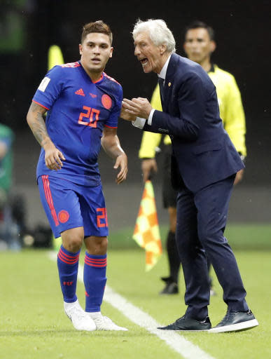 Colombia head coach Jose Pekerman, right, talks to Juan Quintero during the group H match between Poland and Colombia at the 2018 soccer World Cup at the Kazan Arena in Kazan, Russia, Sunday, June 24, 2018. (AP Photo/Frank Augstein)
