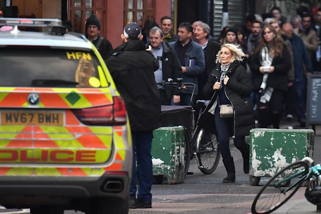 Police guide people away from the vicinity of Borough Market in London.