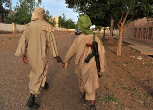Two fighters of the Islamist group Movement for Oneness and Jihad in West Africa (MUJAO) in Gao, Mali on July 17, 2012