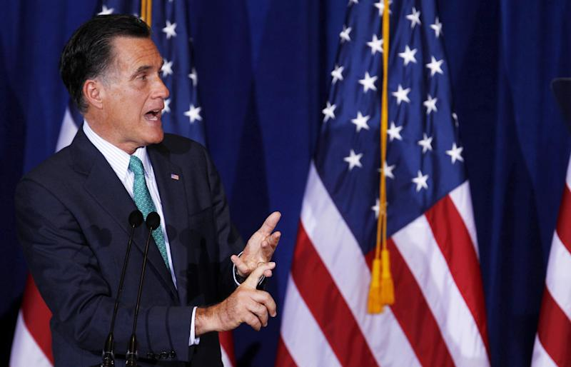 Republican presidential candidate, former Massachusetts Gov. Mitt Romney answers question after speaking at the University of Chicago, Monday, March 19, 2012, in Chicago.  (AP Photo/M. Spencer Green)