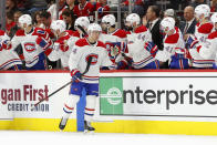 Montreal Canadiens center Nick Suzuki (14) is congratulated for his goal against the Detroit Red Wings during the second period of an NHL hockey game Tuesday, Feb. 18, 2020, in Detroit. (AP Photo/Paul Sancya)