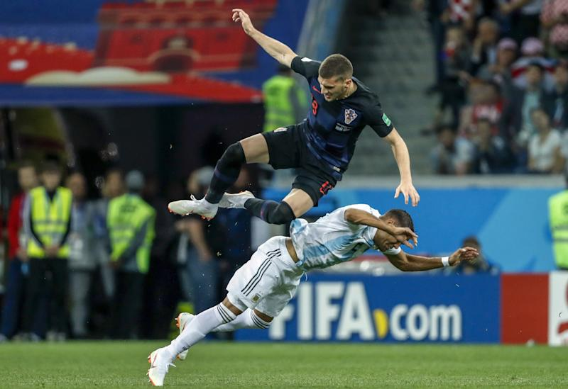 Ante Rebic and Gabriel Mercado thunder into another full-blooded challenge. (Getty)