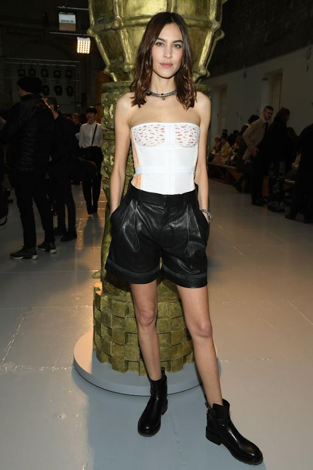 <p>The designer kept it cool in leather shorts. </p>