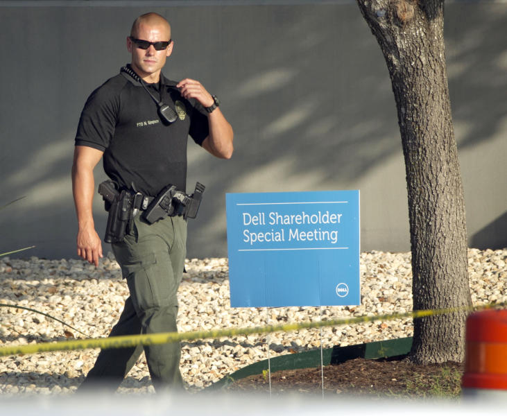 A Round Rock, Texas, police officer guards the Dell shareholders meeting at Dell headquarters in Round Rock, Texas on Thursday, Sept. 12, 2013. The majority of Dell shareholders voted in favor of a $25 billion buyout offer led by company founder and CEO Michael Dell. (AP Photo/Austin American-Statesman, Jay Janner)
