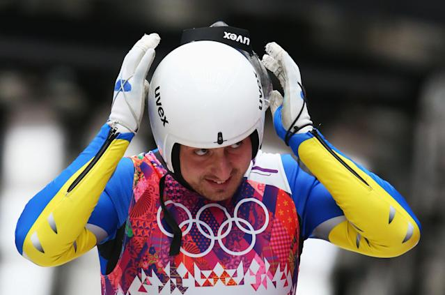 Andriy Mandziy may have fell off his luge on Saturday, but he hopped back on and finished the race. (Getty)