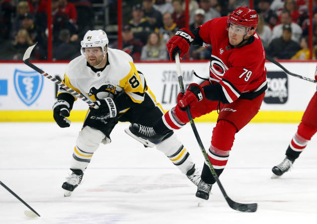 Carolina Hurricanes' Micheal Ferland (79) avoids Pittsburgh Penguins' Phil Kessel (81) to fire the puck on goal during the first period of an NHL hockey game, Tuesday, March 19, 2019, in Raleigh, N.C. (AP Photo/Karl B DeBlaker)