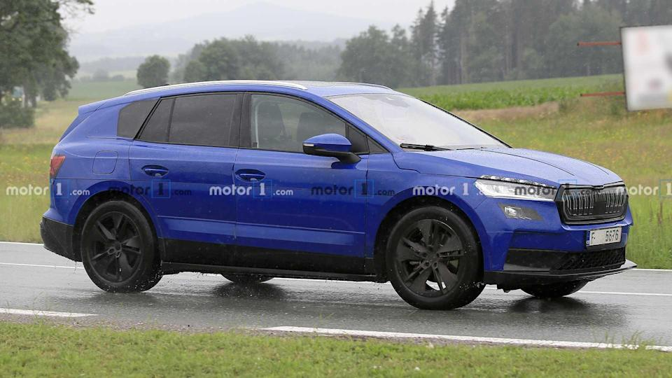 """<p>It requires a close look at this Skoda Enyaq development vehicle to notice that many of the body panels are camouflaging the actual exterior design.</p> <h3><a href=""""https://www.motor1.com/news/434153/skoda-enyaq-electric-spy-photos/"""" rel=""""nofollow noopener"""" target=""""_blank"""" data-ylk=""""slk:Skoda Enyaq Electric SUV Spied Wearing Deceptive Camouflage"""" class=""""link rapid-noclick-resp"""">Skoda Enyaq Electric SUV Spied Wearing Deceptive Camouflage</a></h3> <br><a href=""""https://www.motor1.com/news/433258/skoda-enyaq-spy-video/"""" rel=""""nofollow noopener"""" target=""""_blank"""" data-ylk=""""slk:2021 Skoda Enyaq iV Spied Testing With A Trailer"""" class=""""link rapid-noclick-resp"""">2021 Skoda Enyaq iV Spied Testing With A Trailer</a><br><a href=""""https://www.motor1.com/news/430669/2021-skoda-enyaq-spy-photos/"""" rel=""""nofollow noopener"""" target=""""_blank"""" data-ylk=""""slk:2021 Skoda Enyaq iV Spied In The Alps Looking Familiar"""" class=""""link rapid-noclick-resp"""">2021 Skoda Enyaq iV Spied In The Alps Looking Familiar</a><br>"""