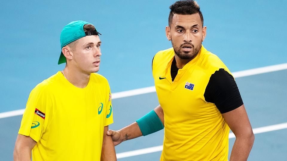 Alex De Minaur (pictured left) talking with Nick Kyrgios (pictured right) during Davis Cup doubles.