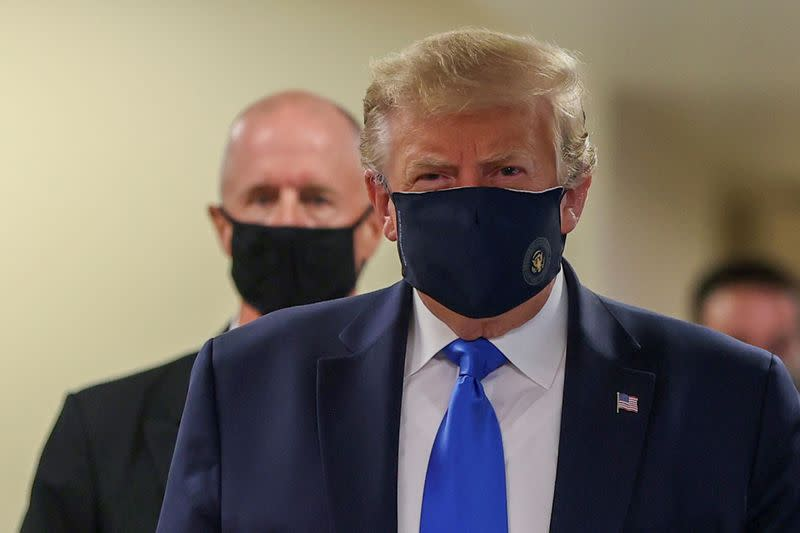 In a first, Trump dons masks in visit to a military medical facility