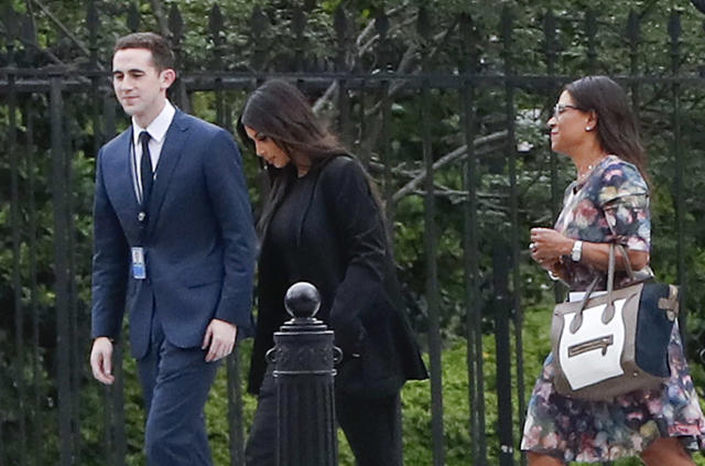 Kim Kardashian, center, arrives at the security entrance of the White House on May 30, 2018. (AP Photo/Pablo Martinez Monsivais)