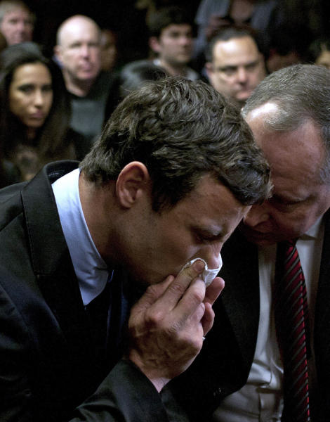 FILE In this Monday, Aug. 19, 2013 file photo, double-amputee Olympian Oscar Pistorius, left, talks with his lawyer, Kenny Oldwage, right, at the magistrates court in Pretoria, South Africa, where Pistorius was indicted on charges of murder and illegal possession of ammunition for the shooting death of his girlfriend on Valentine's Day.Ahead of Pistorius' trial, starting Monday, March 3, 2014, legal experts say Pistorius would still be vulnerable to a homIcide conviction even if he is acquitted of murdering Steenkamp. (AP Photo/Themba Hadebe-File)