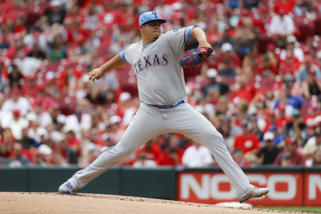 Texas Rangers relief pitcher Ariel Jurado throws in the first inning of a baseball game against the Cincinnati Reds, Sunday, June 16, 2019, in Cincinnati. (AP Photo/John Minchillo)