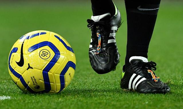 "There are no openly gay or bisexual players in the English men's Premier League, but major clubs have implemented zero-tolerance policies for homophobia and embraced the ""rainbow laces"" campaign against discrimination (AFP Photo/Paul ELLIS)"