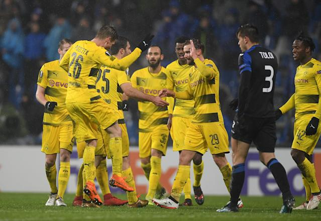 Soccer Football - Europa League Round of 32 Second Leg - Atalanta vs Borussia Dortmund - Stadio Atleti Azzurri, Bergamo, Italy - February 22, 2018 Borussia Dortmund's Marcel Schmelzer celebrates with team mates after scoring their first goal REUTERS/Alberto Lingria