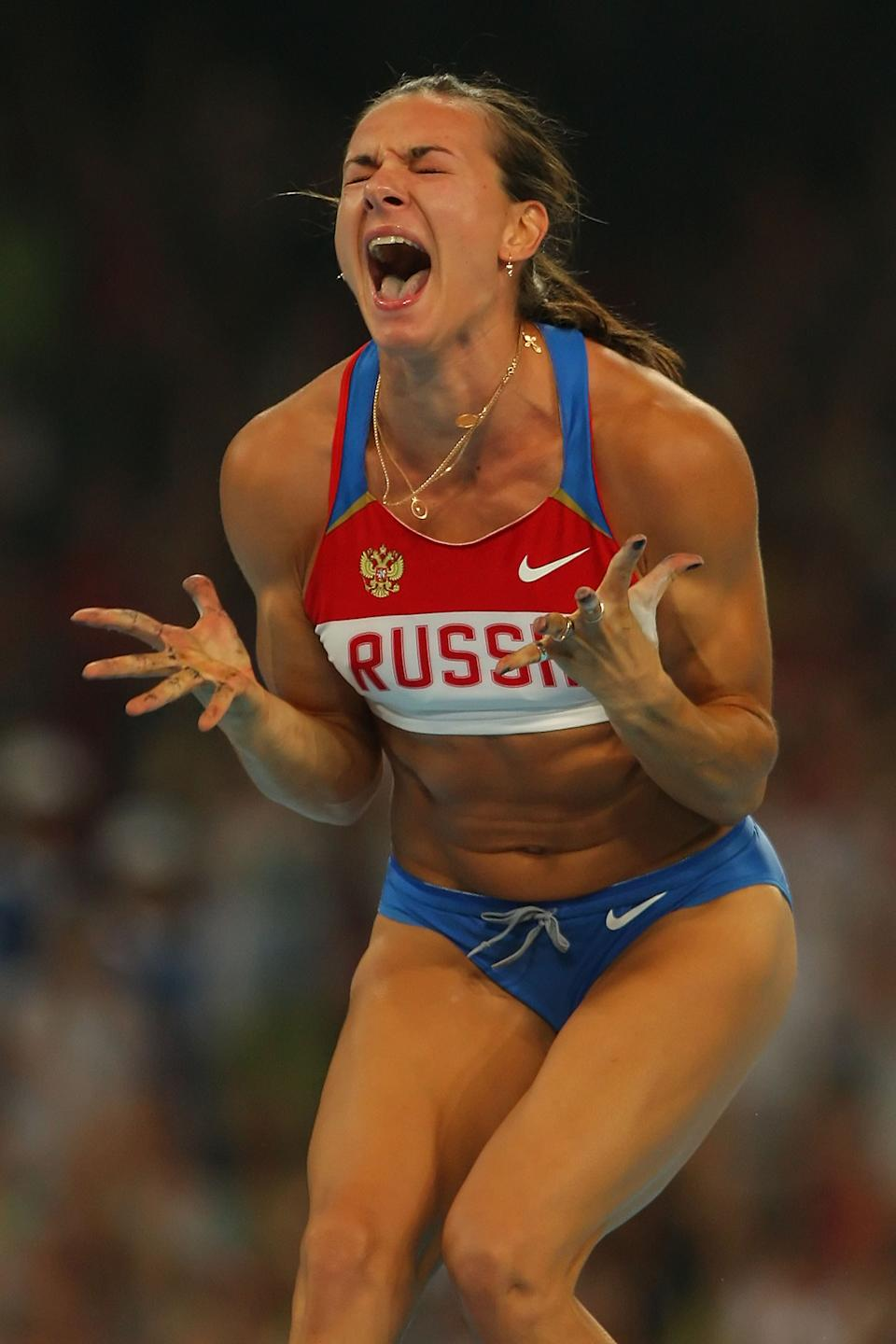 BEIJING - AUGUST 18: Elena Isinbaeva of Russia celebrates successfully jumping a new World Record of 5.05 in the Women's Pole Vault Final at the National Stadium on Day 10 of the Beijing 2008 Olympic Games on August 18, 2008 in Beijing, China. (Photo by Stu Forster/Getty Images)
