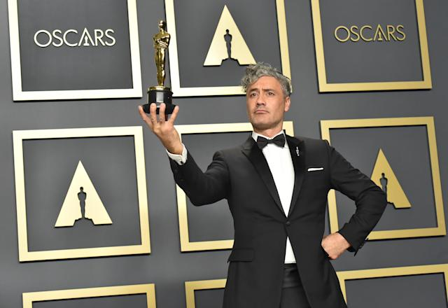 """Writer-director Taika Waititi, winner of the Adapted Screenplay award for """"Jojo Rabbit,"""" poses in the press room during the 92nd Annual Academy Awards at Hollywood and Highland on February 09, 2020 in Hollywood, California. (Photo by Jeff Kravitz/FilmMagic)"""