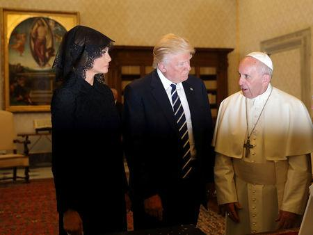 Pope Francis talks with President Donald Trump and his wife Melania during a private audience at the Vatican. REUTERS/Alessandra Tarantino/Pool