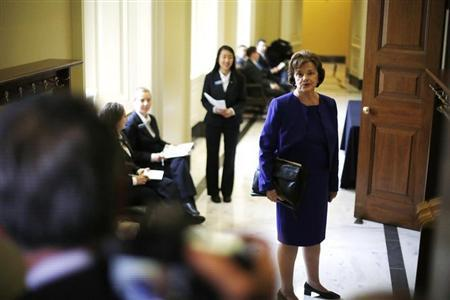 U.S. Senator Feinstein turns to talk to reporters as she walks to the weekly Democratic caucus policy luncheon at the U.S. Capitol in Washington