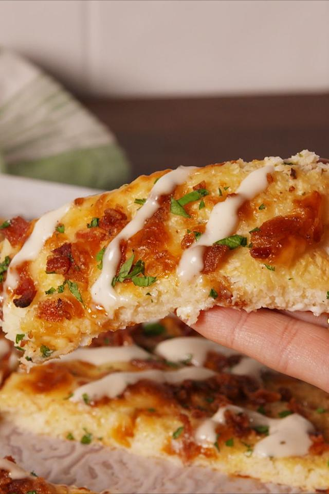 """<p>As if we would ever give up bread.</p><p>Get the recipe from <a rel=""""nofollow"""" href=""""https://www.delish.com/cooking/recipe-ideas/recipes/a57340/bacon-ranch-cauli-bread-recipe/"""">Delish</a>.<br></p><p><strong><em><a rel=""""nofollow"""" href=""""https://www.amazon.com/BLACK-DECKER-FP6010-Performance-Processor/dp/B00VHLXLZM/ref=as_at/?creativeASIN=B00VHLXLZM&linkCode=w61&imprToken=yWHwRficf7U2L-6FZzRZ4g&slotNum=0&s=home-garden&ie=UTF8&qid=1513726263&sr=1-5&keywords=black+and+decker+food+processor&tag=delish_auto-append-20&ascsubtag=[artid%7C1782.a.57340[src%7C"""">Buy Now</a> Food Processor, $150; amazon.com.</em></strong></p>"""