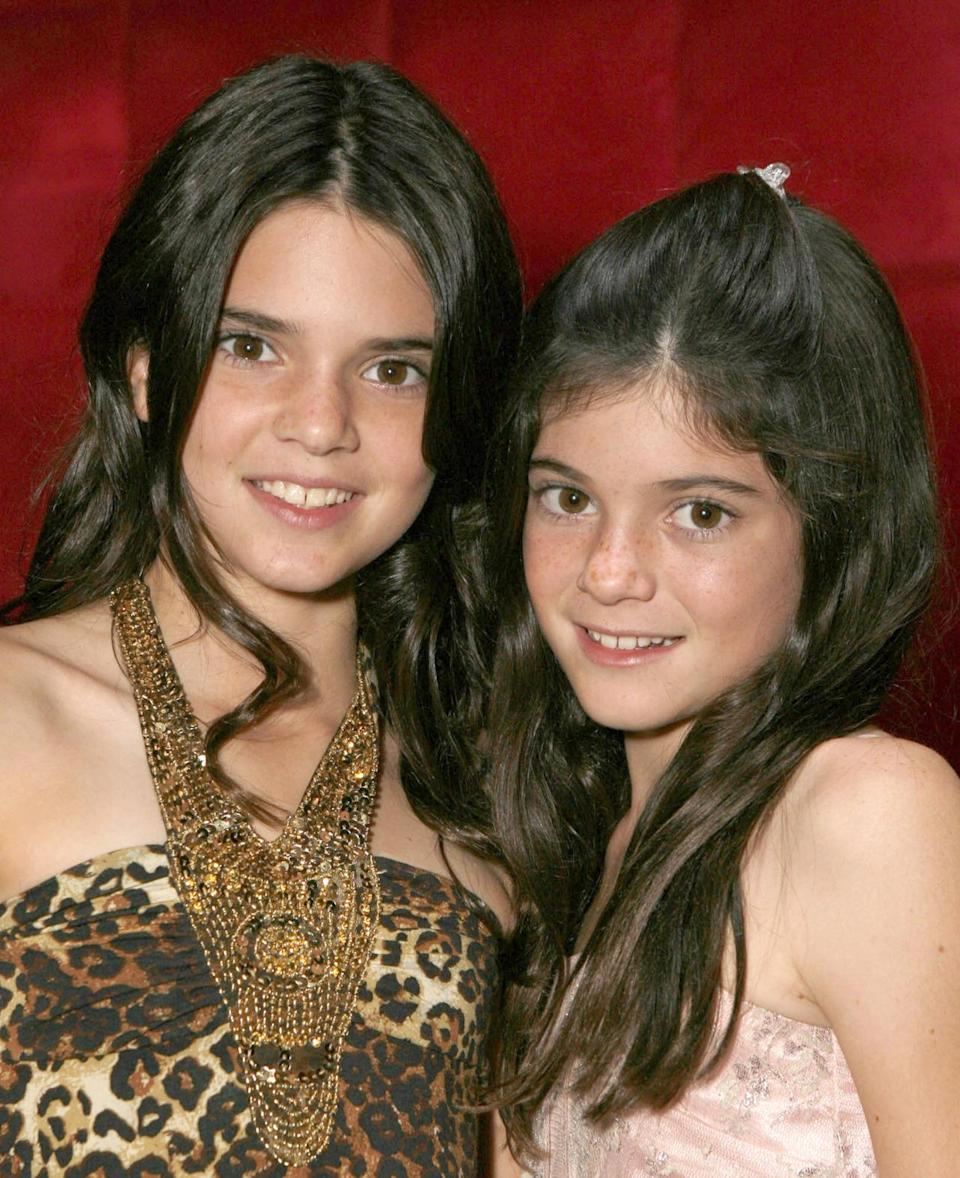 <p>Posing with her younger sister on the red carpet during a viewing of <i>Keeping Up With the Kardashians</i>, Jenner is makeup-free with long, wavy hair — this was before contouring became a trend, after all. <i>(Photo: Getty Images)</i></p>