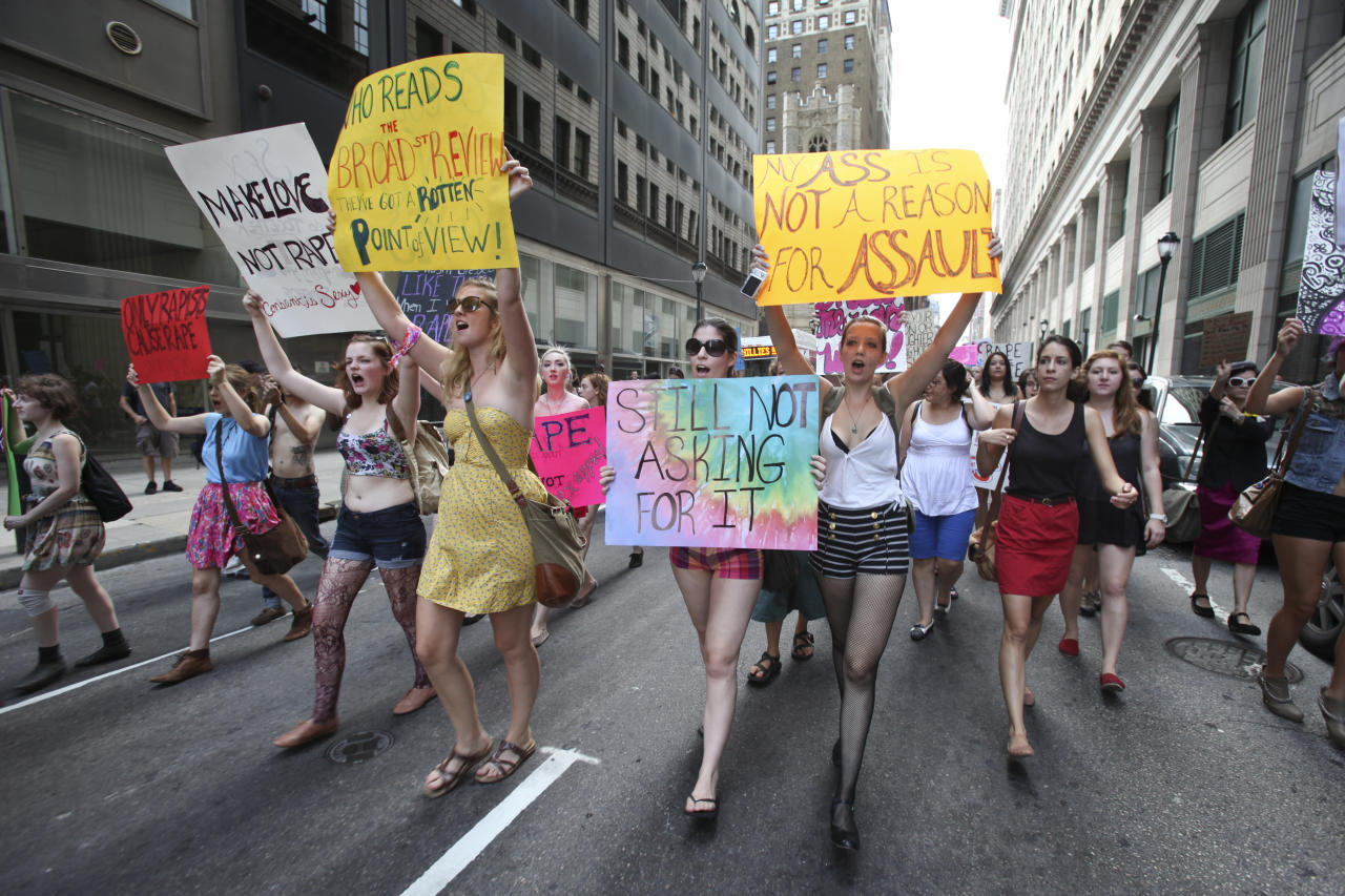 People participate in the Slut Walk demonstration, in Philadelphia, on Saturday, Aug. 6, 2011. Organizers of the walk aim to raise awareness for women's issues including the fact that no woman asks to be raped because of her style of dress. (AP Photo/ Joseph Kaczmarek)