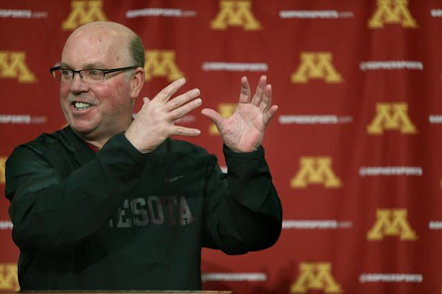 "The University of Minnesota football coach Jerry Kill speaks to the media during a news conference on campus regarding his raise, and spring football, Monday, Feb. 24, 2014 in Minneapolis, Minn. Kill says he's ""getting paid way too much"" to be Minnesota's coach but appreciative of the raise and contract extension he received. (AP Photo/The Star Tribune, Elizabeth Flores)"