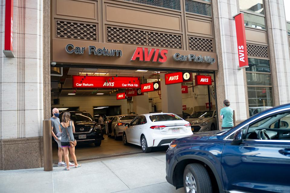 People wearing masks are seen waiting outside an Avis car rental location on the Upper West Side as the city continues Phase 4 of re-opening following restrictions imposed to slow the spread of coronavirus on August 06, 2020, in New York City. (Photo by Alexi Rosenfeld/Getty Images)