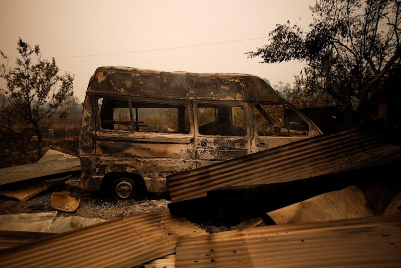 A burned-out vehiclewas left behindby a forest fire near Vale do Couco, Portugal, on Oct. 16, 2017. (Pedro Nunes / Reuters)