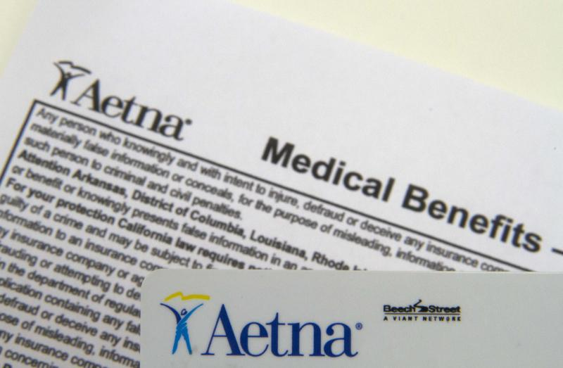FILE - This Jan. 30, 2012 file photo, shows an Aetna benefits card in Surfside, Fla. Aetna's fourth-quarter earnings sank 49 percent as the health insurer's medical costs climbed and it absorbed costs for litigation and the purchase of another insurer, among other expenses the company announced Thursday Jan. 31, 2013.   (AP Photo/Wilfredo Lee, File)