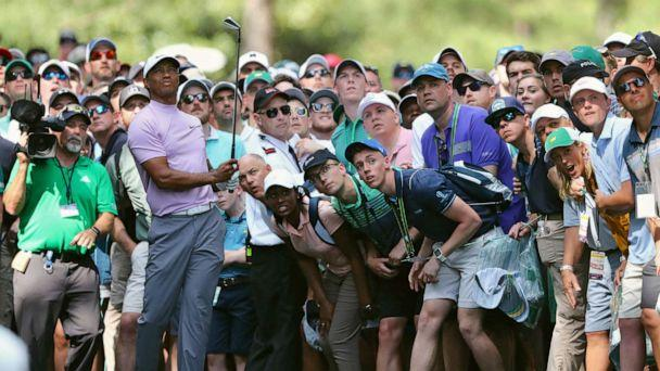 PHOTO: In this April 13, 2019, file photo, Tiger Woods hits from the gallery along the 11th fairway during the third round of the Masters golf tournament at Augusta National in Augusta, Ga. (Curtis Compton/Atlanta Journal-Constitution via AP, FILE)