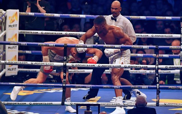 <span>After the uppercut, Joshua caught Klitschko on the way down with a right-hander</span> <span>Credit: AFP PHOTO / Ben STANSALL </span>
