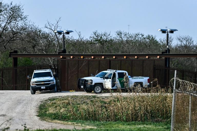 US border Police patrol on the bank of Rio Grande near the Gateway International Bridge, between the cities of Brownsville, Texas, and Matamoros, Mexico on March 16, 2021 in Brownsville, Texas