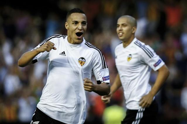 Valencia's Brazilian Forward Rodrigo Moreno (L) celebrates after scoring during the UEFA Champions League playoff football match between Valencia CF vs AS Monaco FC at the Mestalla stadium in Valencia on August 19, 2014. AFP PHOTO/ BIEL ALINO
