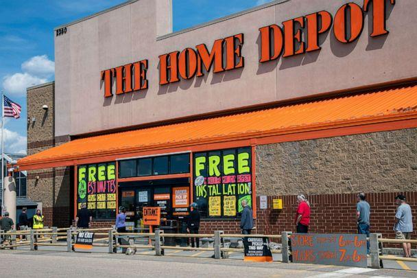 PHOTO: Customers use social distancing while waiting in line outside The Home Depot in Maplewood, Minn, April 26, 2020. (Universal Images Group via Getty Images, FILE)