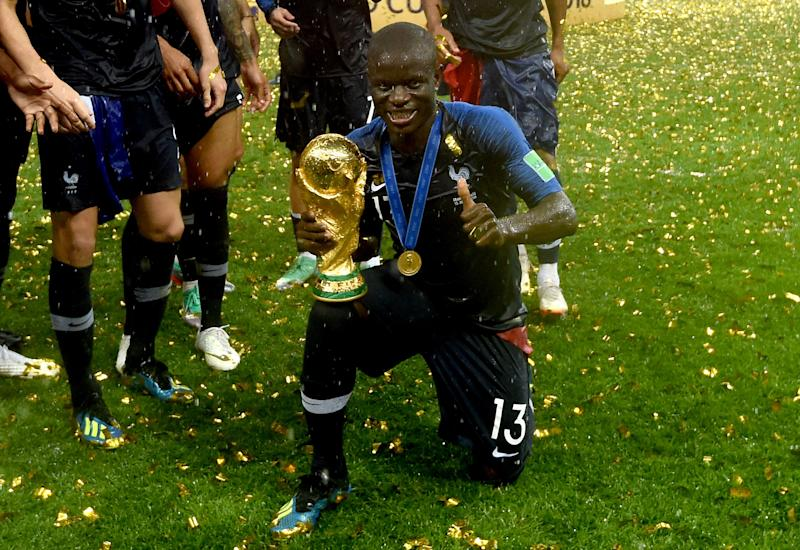 Image result for N'Golo Kanté with world cup trophy