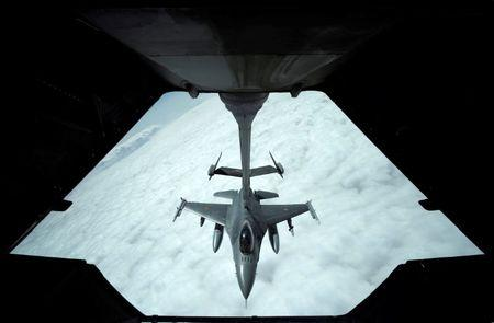 US Air Force F-16 receives fuel from fuel boom suspended from US Air Force's KC-10 Extender during mid-air refueling support to Operation Inherent Resolve over Iraq and Syria air space