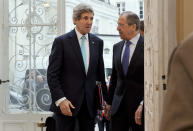In this March 30, 2014, photo, U.S. Secretary of State John Kerry, left, is greeted by Russian Foreign Minister Sergey Lavrov at the Russian Ambassador's Residence to discuss the situation in Ukraine, in Paris. The current trip was to have been a five-day trip to Europe and Saudi Arabia, but with crisis on multiple fronts and Kerry's decision on how to proceed turned a routine trip abroad into a frenetic tour of high-stakes diplomacy marked by abrupt changes in plan that have come to define his 14-month tenure as secretary of state. (AP Photo/Jacquelyn Martin, Pool)
