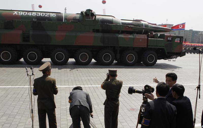 FILE - In this Sunday, April 15, 2012 file photo, a North Korean vehicle carrying what appears to be a new missile passes by during a mass military parade in the Kim Il Sung Square in Pyongyang to celebrate the centenary of the birth of late North Korean founder Kim Il Sung. Analysts sifting through information on North Korea's failed rocket launch say it suggests Pyongyang has learned little about spaceflight since its last flubbed attempt three years ago, and that it's a long way from being able to threaten the United States with a long-range missile. The experts also said an apparently new missile North Korea showed off at a military parade Sunday did not seem to present any major leap forward. Some were more interested in the truck it was carried on. (AP Photo/Ng Han Guan, File)