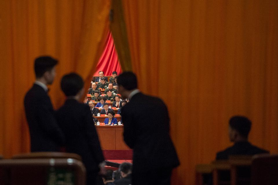 Chinese security guards look at military delegates during the speech of Chinese President Xi Jinping. Source: Getty