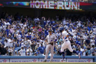 Los Angeles Dodgers' Chris Taylor, right, heads to third after hitting a solo home run as Colorado Rockies third baseman Joshua Fuentes watches during the fifth inning of a baseball game Sunday, July 25, 2021, in Los Angeles. (AP Photo/Mark J. Terrill)