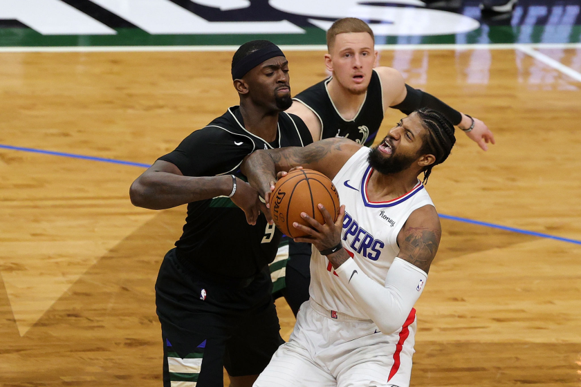 MILWAUKEE, WISCONSIN - FEBRUARY 28: Paul George #13 of the LA Clippers is defended by Bobby Portis.