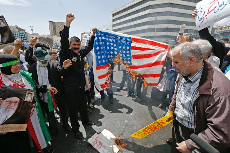Iranian demonstrators burn a makeshift US flag during a rally in the capital Tehran (AFP Photo/STR)