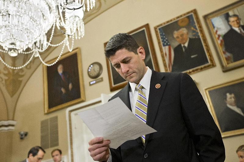 House Budget Committee Chairman Paul Ryan, R-Wis., checks notes as he appears before the House Rules Committee to advance his party's 2014 budget proposal, at the Capitol in Washington, Monday, March 18, 2013. Ryan and fellow House Republicans know their plan would be dead on arrival in the Democrat-controlled Senate because it includes a repeal of President Barack Obama's health care law, and it includes Medicare changes that would shift more of the cost to future patients. (AP Photo/J. Scott Applewhite)
