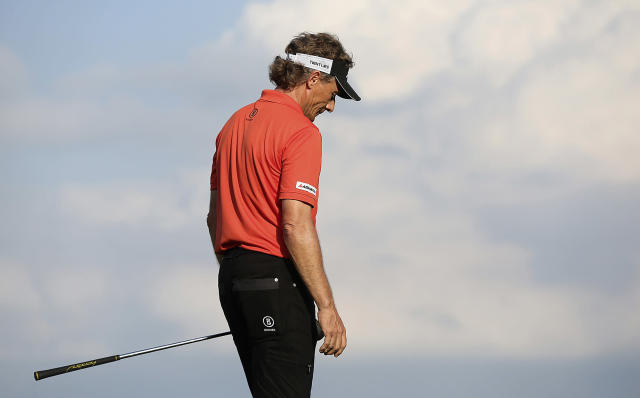 Bernhard Langer looks down after missing a birdie putt on the 18th green sending the tournament into a sudden-death playoff with Kenny Perry in the AT&T Championship at the TPC San Antonio Canyons Course, Sunday, Oct. 27, 2013, in San Antonio, Texas. Perry, of Franklin, New York beat Langer of Munich, Germany. (AP Photo/San Antonio Express-News, Jerry Lara)