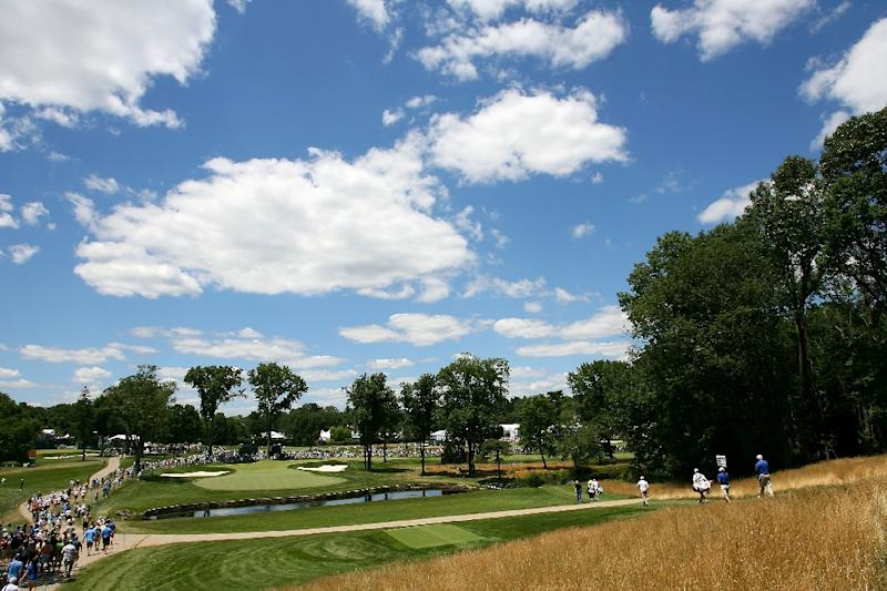 A general view of golfers and spectators is seen as they walk down the fiarway towards the green on the eighth hole during the second round of the AT&T National at Aronimink Golf Club