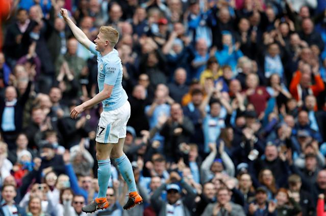 """Soccer Football - Premier League - Manchester City v Swansea City - Etihad Stadium, Manchester, Britain - April 22, 2018 Manchester City's Kevin De Bruyne celebrates scoring their third goal REUTERS/Phil Noble EDITORIAL USE ONLY. No use with unauthorized audio, video, data, fixture lists, club/league logos or """"live"""" services. Online in-match use limited to 75 images, no video emulation. No use in betting, games or single club/league/player publications. Please contact your account representative for further details."""